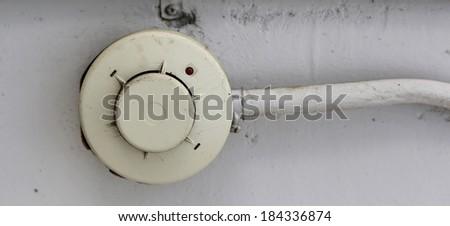 old Smoke detector - stock photo