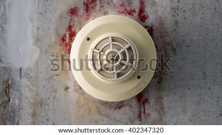 Old smoke detector in cream color. - stock photo