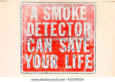 Old smoke detector sign on the old fire station in downtown Roseburg Oregon. - stock photo
