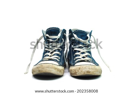 old sneakers dirty sport shoes over white background - stock photo