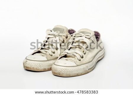 Old sneakers , dust canvas on white background