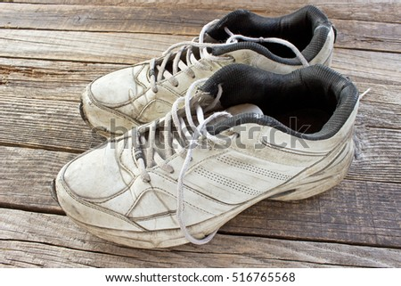 Old sneakers on wooden background