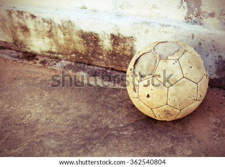 old soccer ball on the retro grunge background  - stock photo