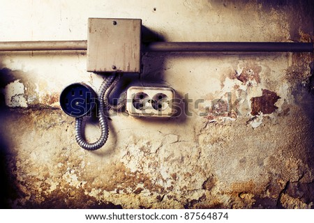 Old sockets on a grunge wall