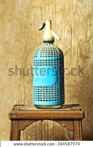 old soda siphon bottle on wooden background  - stock photo