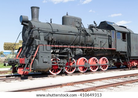 Old Soviet military train locomotive .Black retro train.