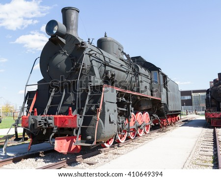 Old Soviet military train locomotive .Black retro train. - stock photo
