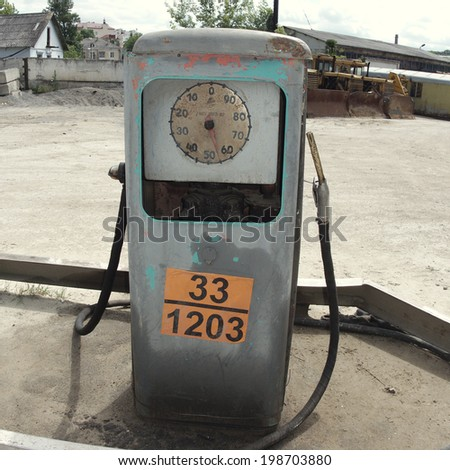Old soviet petrol station front view - stock photo