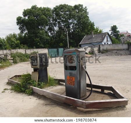 Old soviet petrol station group - stock photo