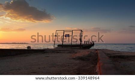 old soviet pier on sunrise - stock photo