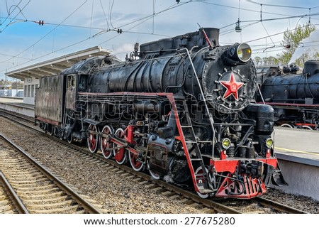Old soviet steam locomotive series L at railway station. - stock photo