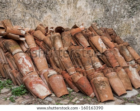 old spanish, mediterranean roofing tiles. Useful for reconstruction, restoration, replacement parts, reconstruction - stock photo