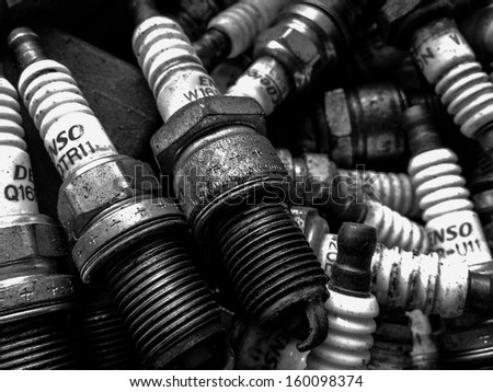 Old spark plugs are used for desertion - stock photo