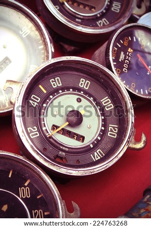 old speedometer for sale in a native used-goods or secondhand trade market in chiang mai, thailand (post-process to be vintage style picture)