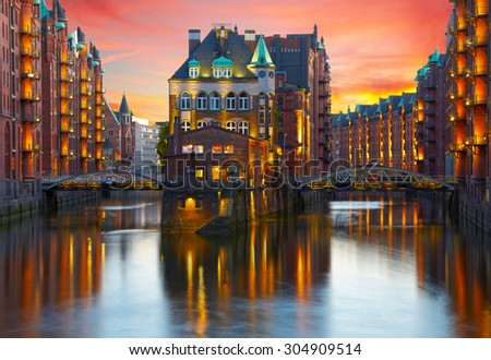 Old Speicherstadt in Hamburg illuminated at night. Sunset background - stock photo