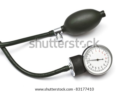 Old sphygmomanometer closeup on white background - stock photo