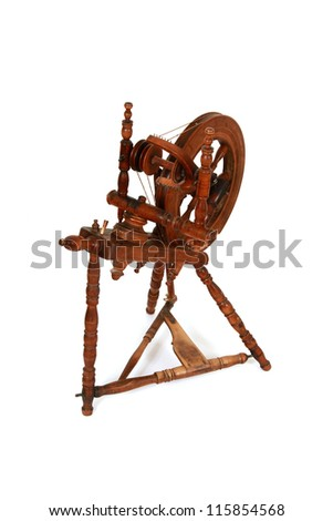 Old spinning wheel isolated on white
