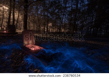 Old spooky graveyard - stock photo