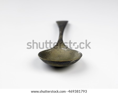old spoon on the white background