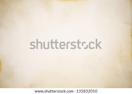 Old, spotty canvas background with vignette - stock photo