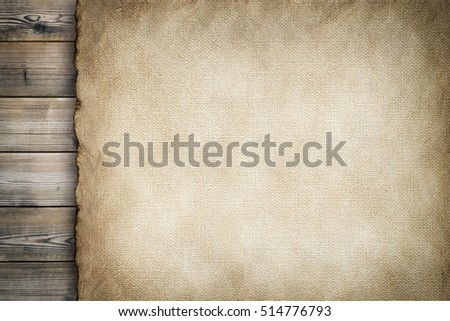 Old stained paper sheet on wooden background