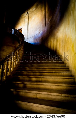 Old staircase made of pure white marble in gothic mood - stock photo