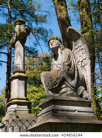 Old statue on grave in the Lychakivskyj cemetery of Lviv, Ukraine. - stock photo