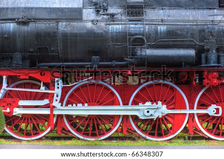 http://thumb1.shutterstock.com/display_pic_with_logo/173680/173680,1291249587,4/stock-photo-old-steam-locomotive-with-big-red-and-white-wheels-side-view-66348307.jpg
