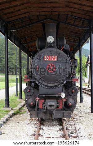 Old steam train locomotive. Big steam locomotive. - stock photo