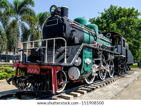 Old steam train on the track - stock photo