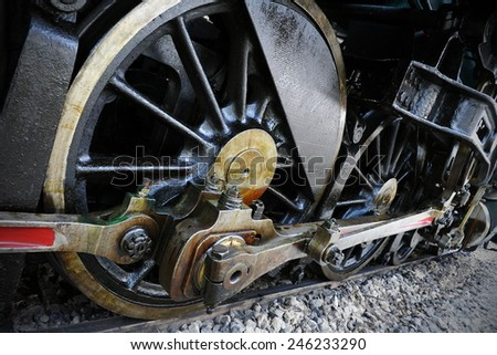 Old Steam Train Wheels - stock photo