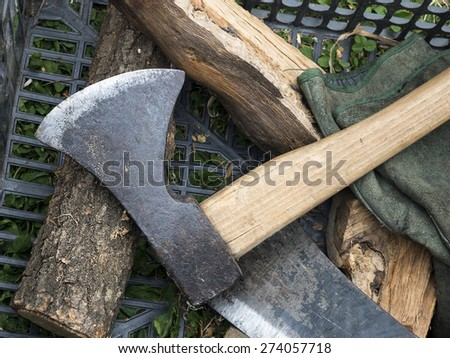 Old steel and wood Axe and splinters of wood - stock photo