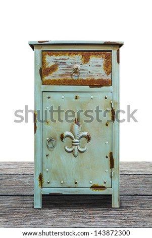 Old steel cabinet isolated on wooden plank floor, interior object, with clipping path - stock photo