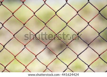 Old steel wire mesh fence closeup background