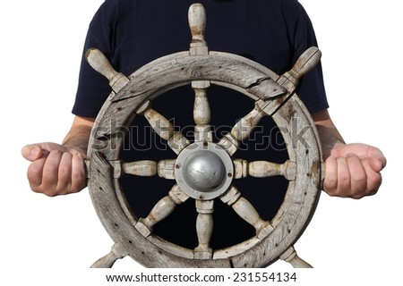 Old steering wheel in sailor hands on the white background  - stock photo
