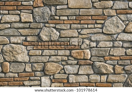 Old stone and brick wall background - stock photo