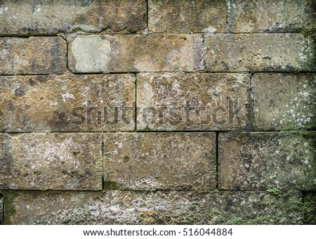Old stone block wall background.