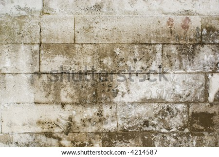 Old stone brick wall with horizontal orientation - stock photo