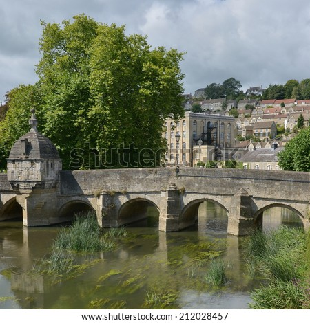 Old Stone Bridge over a River in a Beautiful Town - Namely the Historic Packhorse Bridge Spanning the River Avon in Bradford on Avon in Wiltshire England