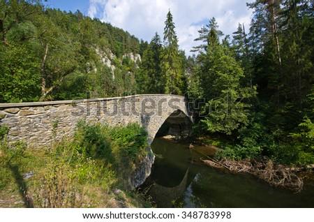 Old stone bridge over the Hornad river - Slovakia Paradise - stock photo