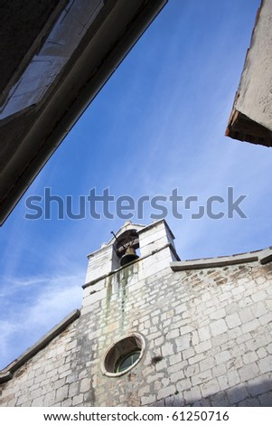 Old stone church with bell on island cres in croatia - stock photo