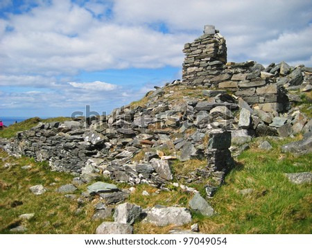 Old stone cottage on Sheep's head peninsula in West Cork in Ireland - stock photo