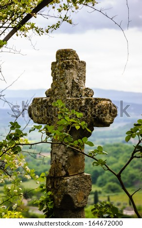 Old stone cross over the valley. Protection concept. Religion background. - stock photo