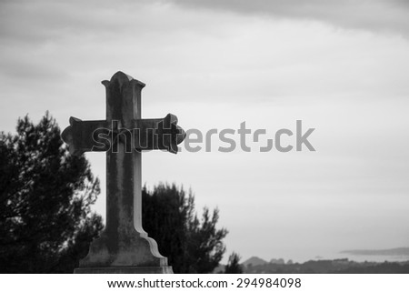 Old stone cross with star over the valley. Religion background. Aged photo. Black and white. - stock photo