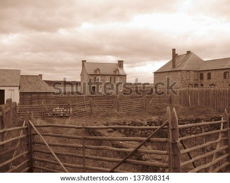 Old stone homes - sepia tone - stock photo