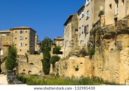 old stone houses built on the rock, region of Luberon, Provence, France - stock photo