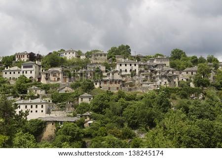 Old stone houses in the village Vitsa of Zagoria, Epirus, Western Greece - stock photo
