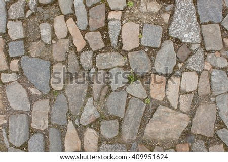 Old stone paving on the street. Detail of historic granite tiles.  - stock photo