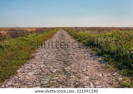 Old stone road - stock photo
