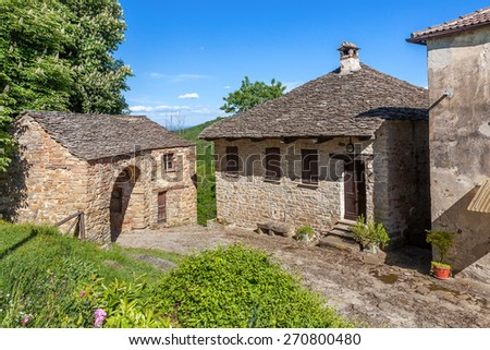 Old stone rural houses in Piedmont, Northern Italy. - stock photo